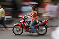Hanoi<br /> , Vietnam - 2007 File Photo -<br /> <br /> A young woman dressed in western clothes drive a motorcycle in a street of hanoi.<br /> <br /> <br /> <br /> photo : James Wong-  Images Distribution