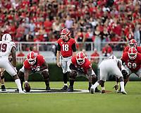 ATHENS, GA - SEPTEMBER 18: JT Daniels #18 calls signals before a game between South Carolina Gamecocks and Georgia Bulldogs at Sanford Stadium on September 18, 2021 in Athens, Georgia.