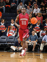 Nov 6, 2010; Charlottesville, VA, USA; Roanoke College g Kwasi Amponsah (11) droibbles the ball Saturday afternoon in exhibition action at John Paul Jones Arena. The Virginia men's basketball team recorded an 82-50 victory over Roanoke College.