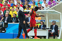 Romelu Lukaku of Belgium refuses to shake the hand of Belgium manager Marc Wilmots as he substituted off
