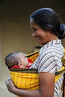 BANGLADESH, Region Madhupur, Garo people, matrilineal society, christian woman, grandmother with child / BANGLADESCH, Madhupur, Garos sind eine christliche u. ethnische Minderheit , Garo folgen einer matrilinearen Abstammungsregel, Garo Frau Kalpona Ritchil mit Enkel im Dorf Idilpur