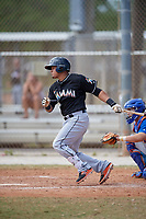 Miami Marlins catcher Rodrigo Vigil (46) follows through on a swing during a minor league Spring Training game against the New York Mets on March 26, 2017 at the Roger Dean Stadium Complex in Jupiter, Florida.  (Mike Janes/Four Seam Images)