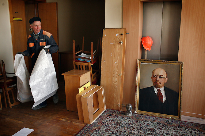 A cleanup worker walks past a damaged portrait of Vladimir Lenin inside the Parliament building in Chisinau, Moldova on 8 April 2009. Anti-communist protesters had stormed and ransacked the Parliament building the previous day after opposition leaders accused the Communists of rigging the elections on 5 April. Moldova is the only former Soviet country that has voted Communists back in to power since the collapse of the USSR.