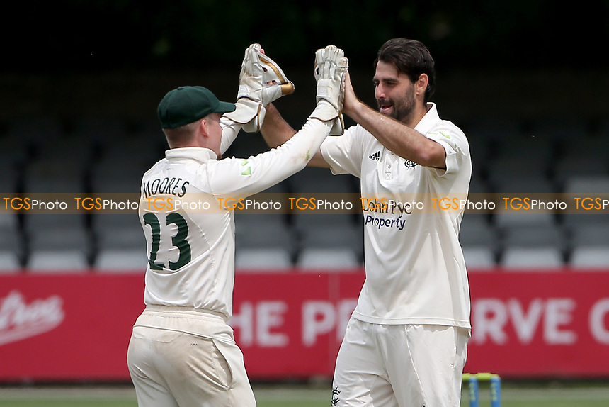 Brett Hutton of Nottinghamshire (R) celebrates taking the wicket of Sam Cook and completes a five wicket haul during Essex CCC vs Nottinghamshire CCC, LV Insurance County Championship Group 1 Cricket at The Cloudfm County Ground on 6th June 2021