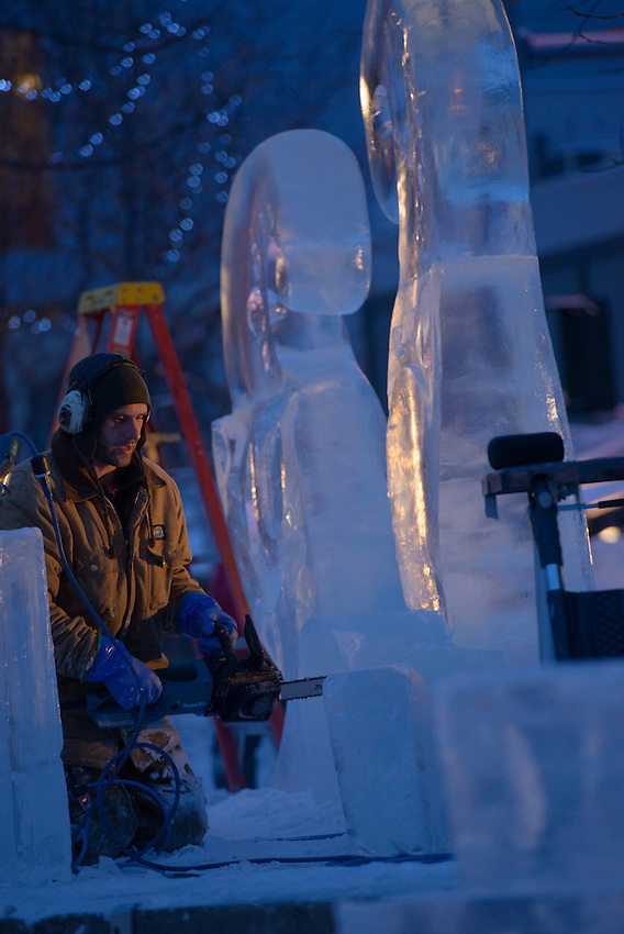 """Two-time winner Paul Hanis works on his sculpture """"Awakening the Courageous Heart"""" on the final morning of the 2016 Crystal Gallery of Ice Ice Carving Competition in town square."""