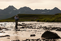 150620-JRE-7981E-0512 Joshua Quong, a teacher and quail hunting guide from Mississippi, ties on a dry fly while pursuing Arctic Grayling on an interior Alaska stream.