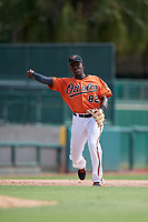 Baltimore Orioles third baseman Jean Carlos Encarnacion (82) throws to first base during a Florida Instructional League game against the Pittsburgh Pirates on September 22, 2018 at Ed Smith Stadium in Sarasota, Florida.  (Mike Janes/Four Seam Images)