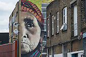 Gentrification in east London. Wall painting on a building in Hackney Wick, a rundown area of warehouses, small industrial units and tenement blocks next to the Olympic Park.
