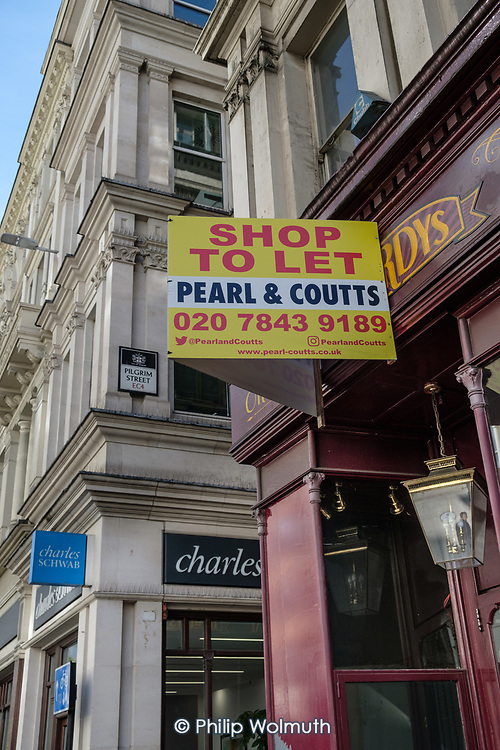 Shop to Let sign on a closed sweetshop, City of London