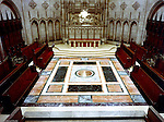 East Liberty PA:  View of the exterior of the East Liberty Presbyterian Church.  Brady Stewart Jr photographed the interior and exterior of the church in 1976. View of the red marble communion table, marble floors, and pews in the Chancel.