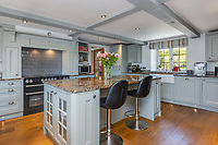 BNPS.co.uk (01202 558833)<br /> Pic: Savills/BNPS<br /> <br /> Pictured: The spacious kitchen.<br /> <br /> A former tidal mill next to an impressive viaduct that looks like the perfect backdrop for a children's book is on the market for £3.5m.<br /> <br /> The Old Mill is over 600 years old and would be an ideal home for Swallows and Amazons or The Railway Children-inspired adventures.<br /> <br /> The impressive Grade II listed six-bedroom house has its own private harbour and panoramic views of the much-photographed Forder Railway Viaduct.<br /> <br /> It is only the second time the property in Cornwall has been on the market since 1886 and agents Savills say it is a once in a lifetime opportunity.