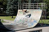 Teenager on a bike uses a skateboard half-pipe next to the communist-era Soviet Army memorial, Sofia.