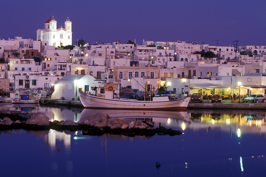 Paros, Greek Islands, Naoussa, Greece, Cyclades, Europe, Fishing boats docked in Naoussa Harbor in the evening on Paros Island on the Aegean Sea.