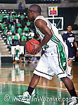 North Texas Mean Green forward Kedrick Hogans (24) gets ready to pass the ball in the game between the Jackson State Tigers and the University of North Texas Mean Green at the North Texas Coliseum,the Super Pit, in Denton, Texas. UNT defeated Jackson 68 to 49