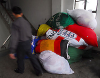 Different kind of National flags are made at the Shanghai Flag and Tent Co. Ltd., on the out-skirts of Shanghai. .