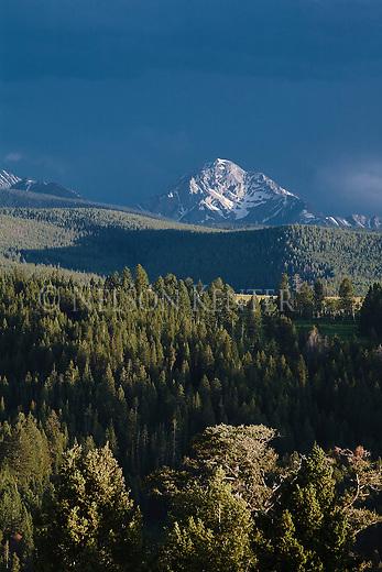 The sun spot lights the peaks in the Anaconda Pintler Mountains