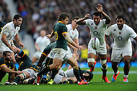 Courtney Lawes of England charges down Pat Lambie of South Africa's clearance kick during the QBE International match between England and South Africa at Twickenham Stadium on Saturday 15th November 2014 (Photo by Rob Munro)