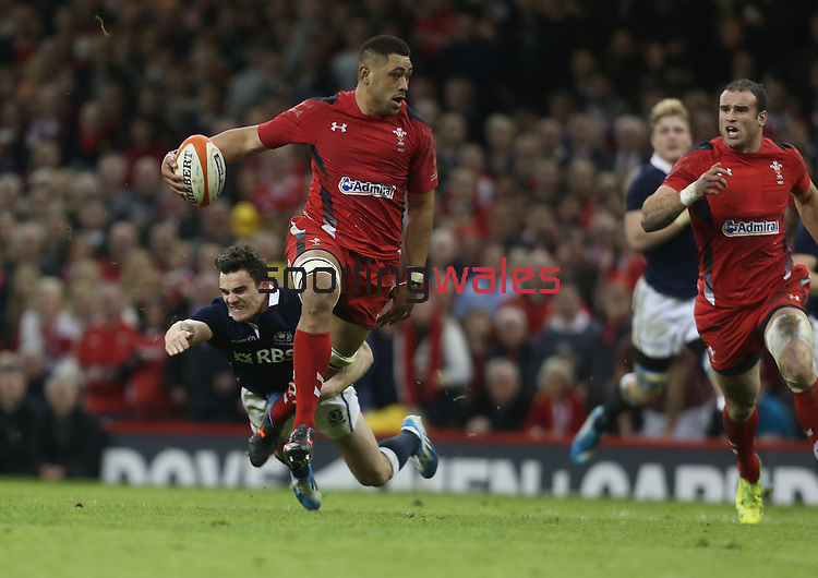 Wales number 8 Taulupe Faletau looks inside for support from Jamie Roberts as Scotland wing Max Evans dives in to make the tackle.<br /> RBS 6 Nations 2014<br /> Wales v Scotland<br /> Millennium Stadium<br /> <br /> 15.03.14<br /> <br /> ©Steve Pope-SPORTINGWALES