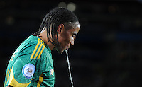 Steven Pienaar of South Africa spits out water. Brazil defeated South Africa 1-0 during the semi-finals of the FIFA Confederations Cup at Ellis Park Stadium in Johannesburg, South Africa on June 25, 2009..