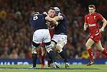 Scotland pair Alasdair Strokosch and David Denton stop Wales wing Alex Cuthbert.<br /> RBS 6 Nations 2014<br /> Wales v Scotland<br /> Millennium Stadium<br /> <br /> 15.03.14<br /> <br /> ©Steve Pope-SPORTINGWALES