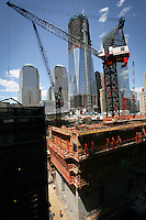 Tenth anniversary of 9/11.  Rebuilding at the World Trade Center site.  Crane atop under construction transportation hub.  One World Trade Center is directly behind the hub.  Photo by Ari Mintz.  8/11/2011.