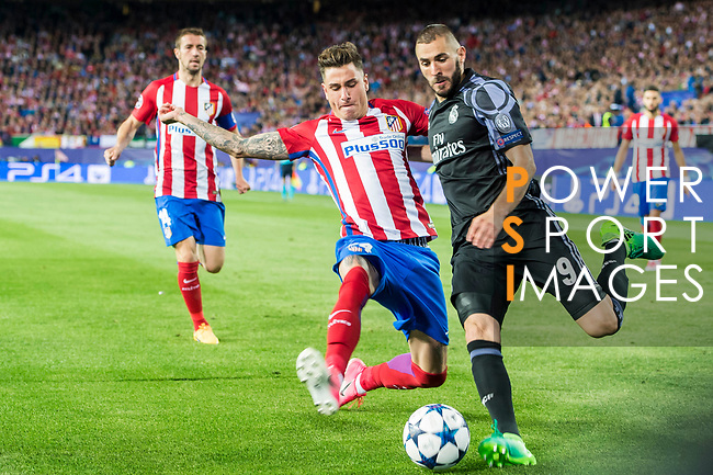 Karim Benzema (r) of Real Madrid battles for the ball with Jose Maria Gimenez de Vargas of Atletico de Madrid in action during their 2016-17 UEFA Champions League Semifinals 2nd leg match between Atletico de Madrid and Real Madrid at the Estadio Vicente Calderon on 10 May 2017 in Madrid, Spain. Photo by Diego Gonzalez Souto / Power Sport Images