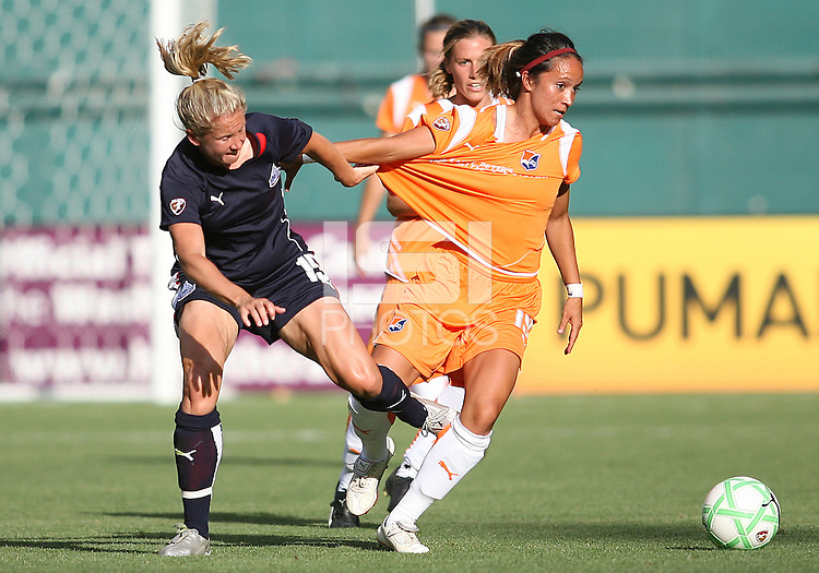 Rebecca Moros #19 of Washington Freedom pulls on the shirt of Mele French #19 of Sky Blue FC during a WPS match at RFK Stadium on May 23, 2009 in Washington D.C. Freedom won the match 2-1