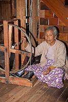 Myanmar, Burma.  Burmese Woman Making Yarn out of Lotus Fibers,  Inle Lake, Shan State.