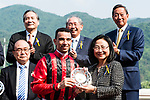 Jockey Joao Moreira (L) who rode Eagle Way poses with his trophy after winning the Race 6 Queen Mother Memorial Cup (G3 2400m) during the Audemars Piguet Queen Elizabeth II Cup Day at Sha Tin Racecourse on April 30, 2017 in Hong Kong, China. (Photo by Marcio Rodrigo Machado / Power Sport Images)