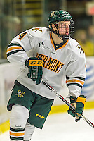 29 December 2014: University of Vermont Catamount Defenseman Trey Phillips, a Freshman from Okotoks, Alberta, in first period action against the Providence College Friars, during the deciding game of the annual TD Bank-Sheraton Catamount Cup Tournament at Gutterson Fieldhouse in Burlington, Vermont. The Friars shut out the Catamounts 3-0 to win the 2014 Cup. Mandatory Credit: Ed Wolfstein Photo *** RAW (NEF) Image File Available ***