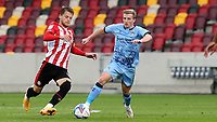 Mathias Jensen of Brentford and Coventry City's Jamie Allen challenge for the ball during Brentford vs Coventry City, Sky Bet EFL Championship Football at the Brentford Community Stadium on 17th October 2020