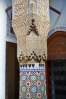 Arabesque Moorish plasterwork column capitals and zellij tiles of the Dar Jamai Museum  a typical dwellings of high Moroccan bourgeoisie at the end of XIX century. located in the old Medina built by Mohamed Ben Larbi Jamai grend vizier of Sultan Moulay Hassan (1873-1894). Meknes, Morocco
