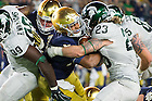 September 17, 2016; Quarterback DeShone Kizer (14) fights his way into the end zone for a touchdown against Michigan State. (Photo by Matt Cashore)
