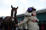 Co-owner Steve Coburn hugs exercise rider Willie Delgado after California Chrome won the 139th running of the Preakness to keep hope alive for the first Triple Crown since 1978. Their horse defeated nine foes to win the Preakness at Pimlico Race Course in Baltimore, Maryland on May 17, 2014.