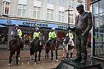 © Joel Goodman - 07973 332324 - all rights reserved . 20/03/2010 . Bolton , UK . Mounted police on duty beside a statue of Bolton son Fred Dibnah . The English Defence League ( EDL ) hold a demonstration in Bolton , opposed by Unite Against Fascism ( UAF ) . Photo credit : Joel Goodman