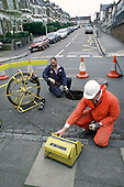 Local authority inspectors check street drains in Haringey, North London.