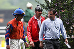 Jockey Richard Migliore talks with trianer after the   Obeah Stakes at Delaware Park in New Stanton, Delaware 06.20.09