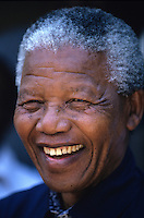 Nelson Mandela speaks to supporters at a campaign event.   After more then 27 years in jail as an anti-apartheid activist,   Nelson Mandela lead a 1994 campaign for President as a member of the African National Congress (ANC),  in the first free elections in South Africa in 1994.  Mandela has received more than 250 awards over four decades, including the 1993 Nobel Peace Prize..