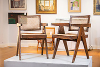 BNPS.co.uk (01202 558833)<br /> Pic: MaxWillcock/BNPS<br /> <br /> Pictured: The Chandigarh furniture, in the saleroom at Duke's in Dorchester, Dorset.<br /> <br /> Retro Indian chairs once consigned to the scrapheap are now tipped to sell for thousands of pounds after the style of furniture was endorsed by the Kardashians.<br /> <br /> The value of the distinctive solid teak chairs has sky-rocketed in recent years after ones like them were used to adorn the home of influencers like Kim and Khloe Kardashian.<br /> <br /> They were originally designed by Swiss architect Pierre Jeanneret to furnish public buildings of one of India's first modern cities in the 1950s.