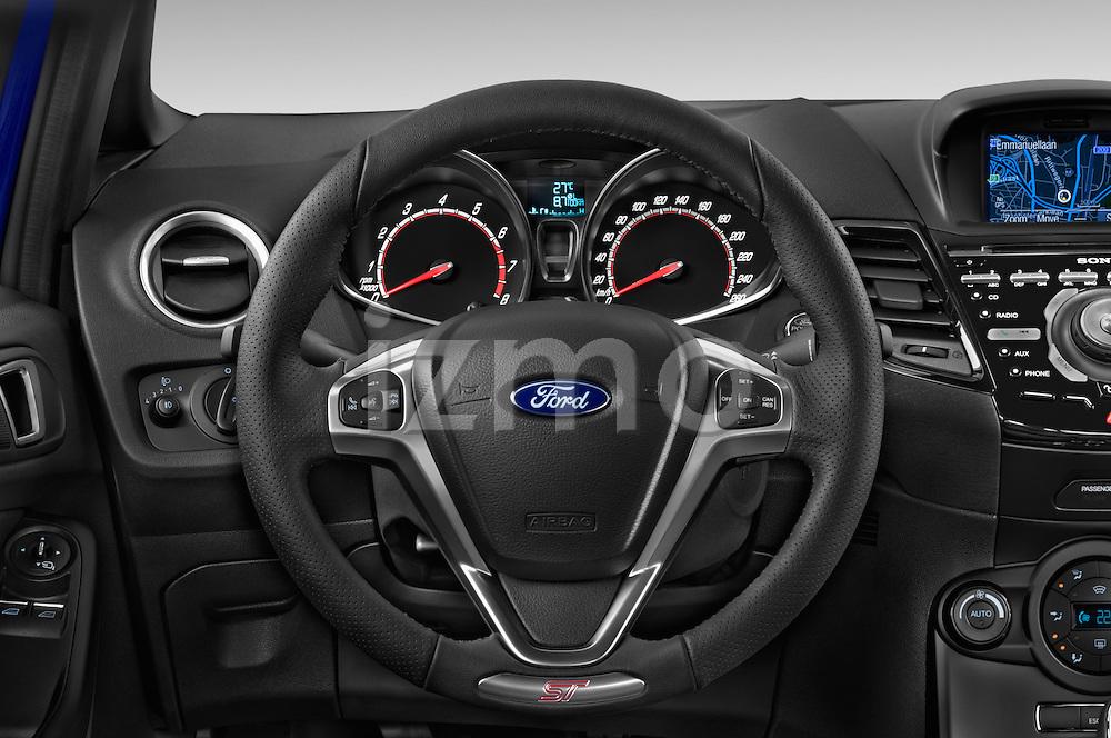 Car pictures of steering wheel view of  a 2014 Ford FIESTA ST MT 2WD 3 Door Hatchback 2WD Steering Wheel