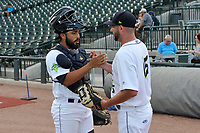 Starting pitcher Zac Grotz (15) of the Columbia Fireflies shakes hands with catcher Carlos Sanchez after warm-ups for a game against the Charleston RiverDogs on Wednesday, August 29, 2018, at Spirit Communications Park in Columbia, South Carolina. Charleston won, 6-1. (Tom Priddy/Four Seam Images)
