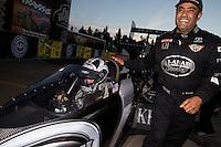 Nov 9, 2013; Pomona, CA, USA; Khalid Albalooshi (right) congratulates NHRA top fuel dragster driver Shawn Langdon after clinching the 2013 championship following qualifying for the Auto Club Finals at Auto Club Raceway at Pomona. Mandatory Credit: Mark J. Rebilas-