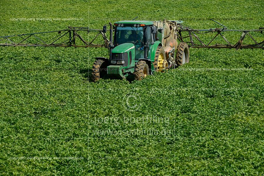 EGYPT, Cairo Alexandria desert road, potato farming in the desert, Daltex Corporation, JD tractor with pesticide spraying tank / AEGYPTEN, Daltex Corporation, Kartoffelanbau in der Wueste, Traktor mit Tank fuer Pestizide
