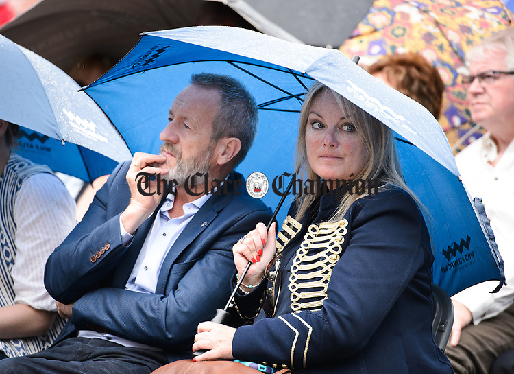 MEP Sean Kelly and Cllr. Mary Howard sharing a brolly at the official opening of the All-Ireland Fleadh 2017 in Ennis. Photograph by John Kelly.