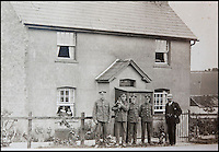 BNPS.co.uk (01202 558833)<br /> Pic: PhilYeomans/BNPS<br /> <br /> Pte Ambrose (3rd right) and Pals outside his home as they went off to war - His sisters look from a window and his father is also in the picture.<br /> <br /> Discovered in a loft - Poingnant reminder of families tragic loss during the Great War.<br /> <br /> A moving time capsule containing the last belongings of a dead soldier his family couldn't bring themselves to look at has been found in an attic after 98 years.<br /> <br /> The possessions of Private Edward Ambrose were sent home from the Western Front to his devastated parents after he was killed at the Somme.<br /> <br /> Too painful to look at, the poignant items were shut into a leather case and put into storage where they remained for almost a century.<br /> <br /> The case has now been opened by Pvt Ambrose's 82-year-old nephew who recovered it after reading about an appeal for untold stories for a local First World War exhibition.<br /> <br /> The effects include black and white photos of his loved ones, letters from his parents, his half-smoked pipe and a cigarette case with 10 roll-ups.