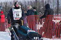 Kurt Reich team leaves the start line during the restart day of Iditarod 2009 in Willow, Alaska