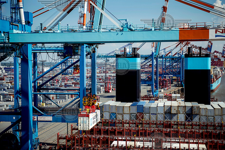 Containers are loaded onto the Mary Maersk, the world's largest container ship, at Bremerhaven.