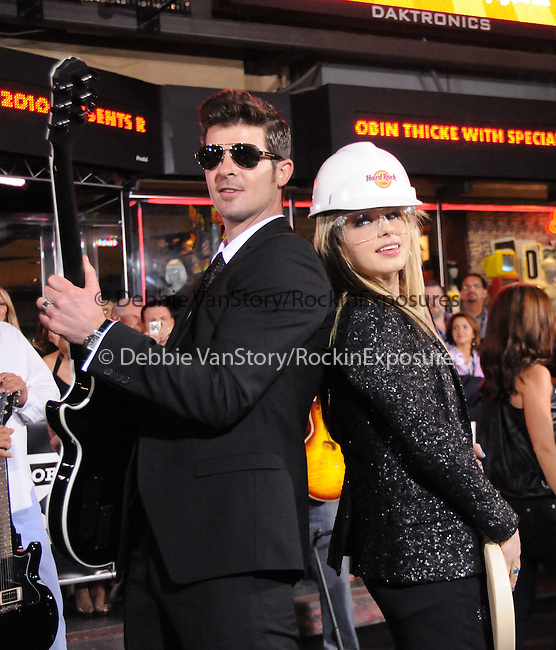 Robin Thicke and Orianthi at The Hard Rock Cafe Hollywood's grand opening party in Hollywood, California on October 21,2010                                                                               © 2010 Hollywood Press Agency