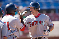 Sean Rooney #5 of the Potomac Nationals is congratulated by his teammates after hitting a 3-run home run in the top of the 7th inning that gave the Nationals a 5-4 lead over the Winston-Salem Dash at Wake Forest Baseball Park May 10, 2009 in Winston-Salem, North Carolina. (Photo by Brian Westerholt / Four Seam Images)