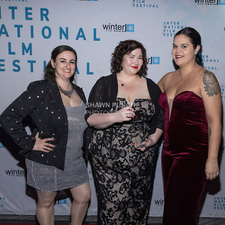 Elaine White, Katharine Scarborough and Alyssa Cartee attends the 10th Annual Winter Film Awards International Film Festival Gala on October 2, 2021 at 230 Fift Avenue in New York City.